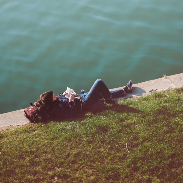 woman-reading-park-lake_s